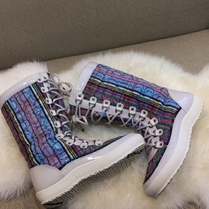 Coach signature snow boot with sherpa lining.